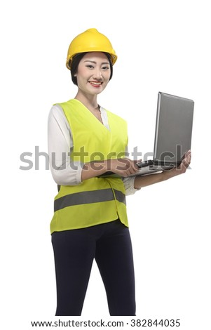Asian worker woman holding laptop isolated over white background - stock photo