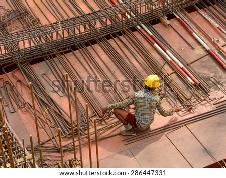 Asian workers working at the construction site in Yangon city, Myanmar. - stock photo