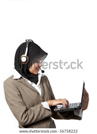 Asian  working lady on the wireless phone and laptop