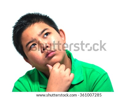 Asian 13 years old boy making doubt thinking expression isolated over white  background. Photo is focused at his eyes.