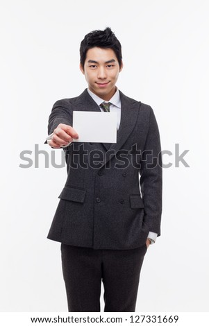 Asian young business man with blank card isolated on white background.