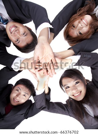 Asian Young Business people joining their hands - stock photo