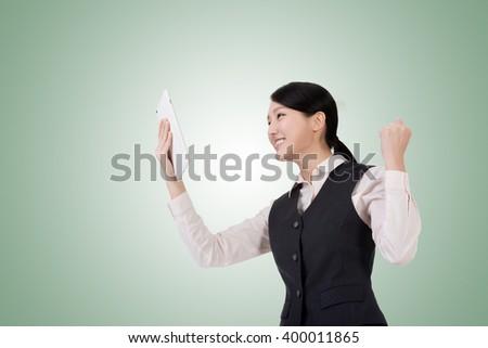 asian young business woman using pad, closeup portrait - stock photo