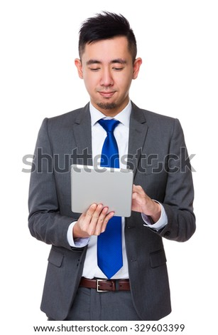 Asian Young Businessman use of the mobile phone