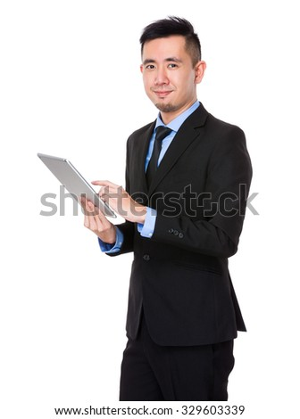Asian Young Businessman use of the tablet pc