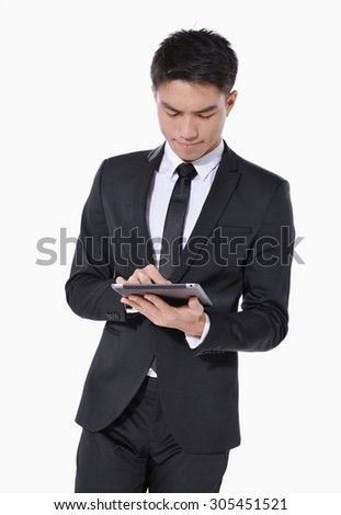 Asian young businessman Using Digital Tablet Isolated   - stock photo