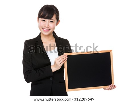 Asian young businesswoman hold with blackboard