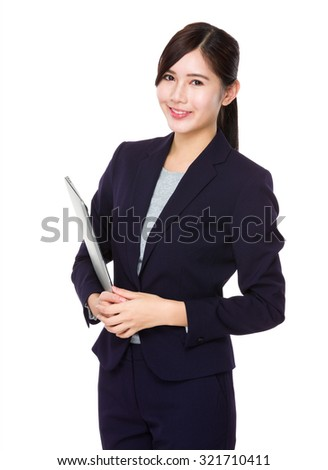 Asian young businesswoman hold with notebook computer