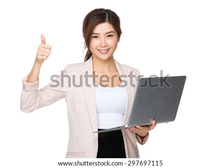 Asian young businesswoman hold with notebook computer and thumb up - stock photo