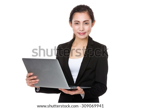 Asian Young businesswoman use of the notebook computer - stock photo