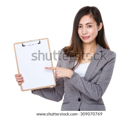 Asian young businesswoman with finger point to clipboard - stock photo