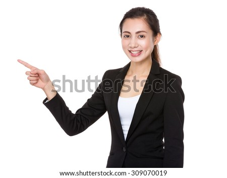 Asian Young businesswoman with finger point up - stock photo