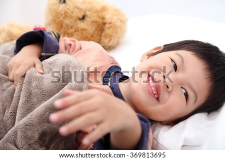 Asian young child wakes up in the morning on the bedroom.