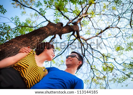 Asian young couple in love under the tree, Outdoor portrait - stock photo