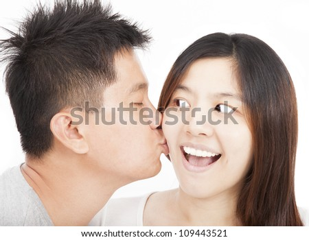 asian young couple kissing - stock photo