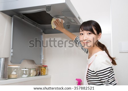 asian young girl cleaning up kitchen