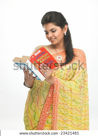 Asian young girl reading the book - stock photo