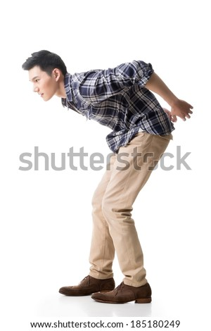 Asian young guy carry or take something, full length model isolated on white. - stock photo