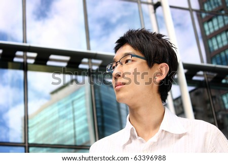 asian young, handsome business man at the office building . - stock photo