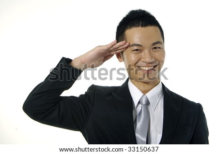 Asian young man by greeting gesture on white - stock photo