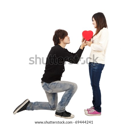 Asian young Man handing over love gift  to  young woman on Valentine Day isolated on white background