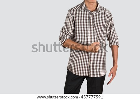 Asian young man in plaid shirt give encouragement hand sign, isolated shot in studio photography. - stock photo