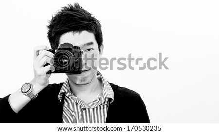 Asian young man photographer isolated with white background