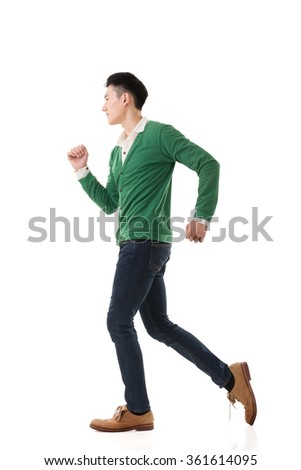 Asian young man running, full length portrait isolated on white.