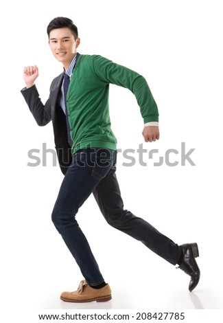 Asian young man running with casual clothes mix business suit, concept of life and work balance. - stock photo