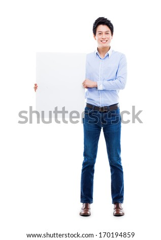 Asian young man showing pannel isolated on white background.