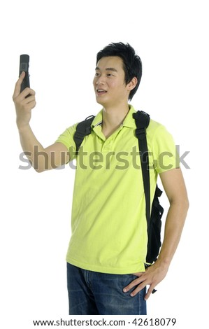 Asian young man using his mobile phone