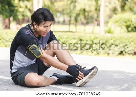 Asian young sport man ankle