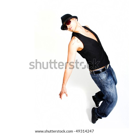Asian young stylish dancer over white background.