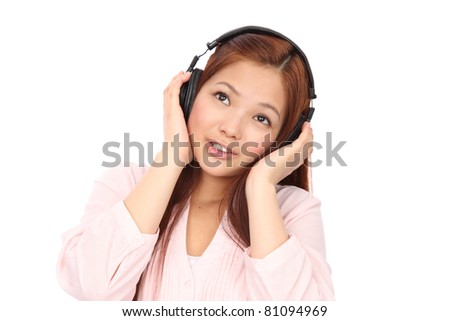 Asian young teen listening to music - stock photo