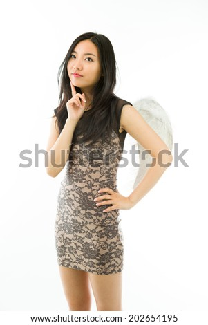 Asian young woman dressed up as an angel standing with her hand on hip isolated on white background - stock photo