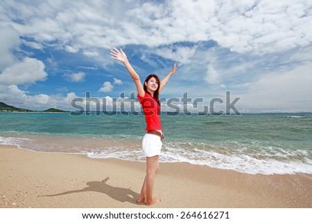 Asian young woman enjoy the sun. - stock photo