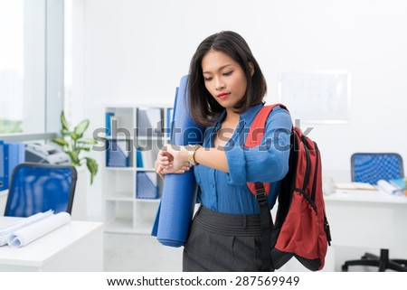 Asian young woman hasting at sport training - stock photo