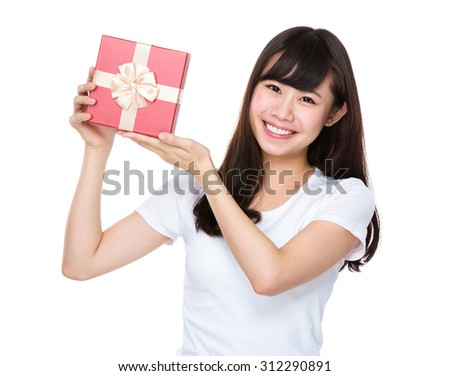 Asian young woman hold with gift box - stock photo