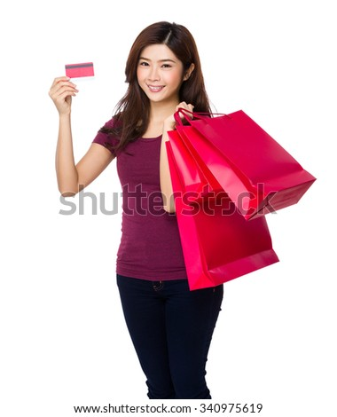 Asian Young Woman hold with shopping bag and credit card