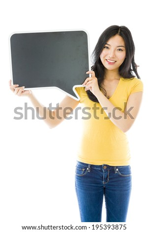 Asian young woman holding a blank speech bubble - stock photo
