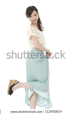 Asian young woman in pastel dress isolated on white background