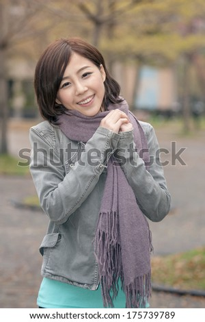 Asian young woman portrait at outdoor in city.
