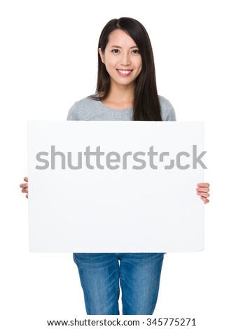 Asian Young Woman showing with white banner - stock photo