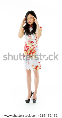 Asian young woman suffering from headache - stock photo