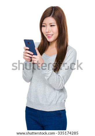 Asian Young Woman use of the mobile phone - stock photo