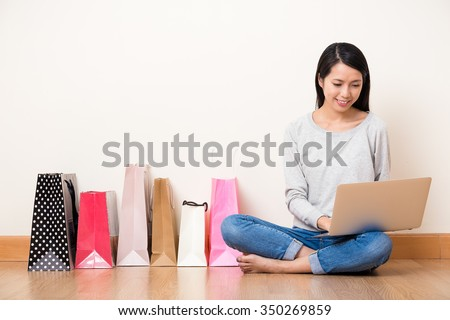 Asian Young Woman use of the notebook computer for shopping online - stock photo