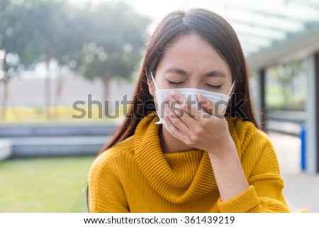 Asian Young woman wearing face mask - stock photo