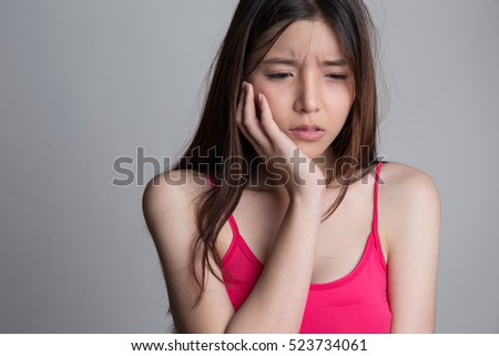 Asian young woman with toothache