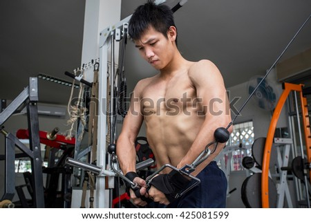 Asian youth at the fitness. - stock photo