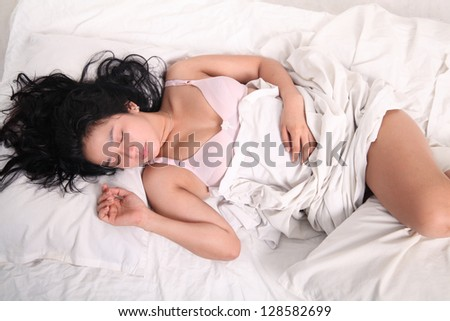 asian yung woman sleeping on bed wearing sexy underwear - stock photo